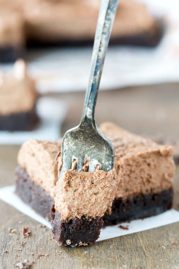 Chocolate mousse brownie with a fork taking a bite