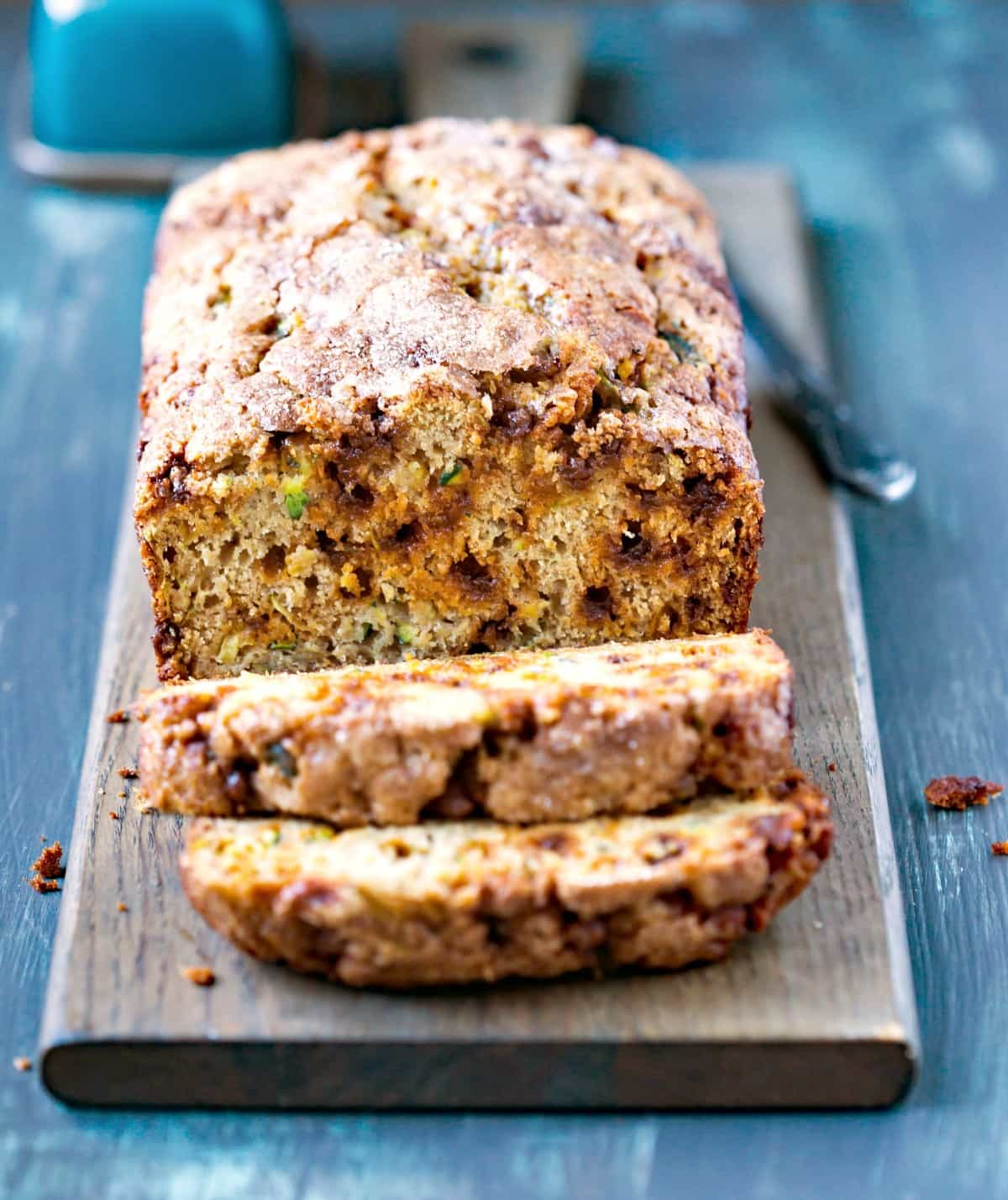 Sliced loaf of Cinnamon Chip Whole Wheat Zucchini Bread