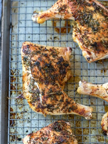 Herb roasted chicken on a baking sheet