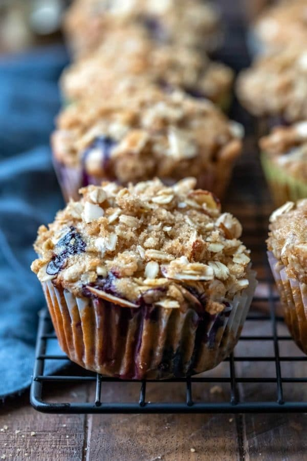 Healthy blueberry muffins on a dark wire cooling rack