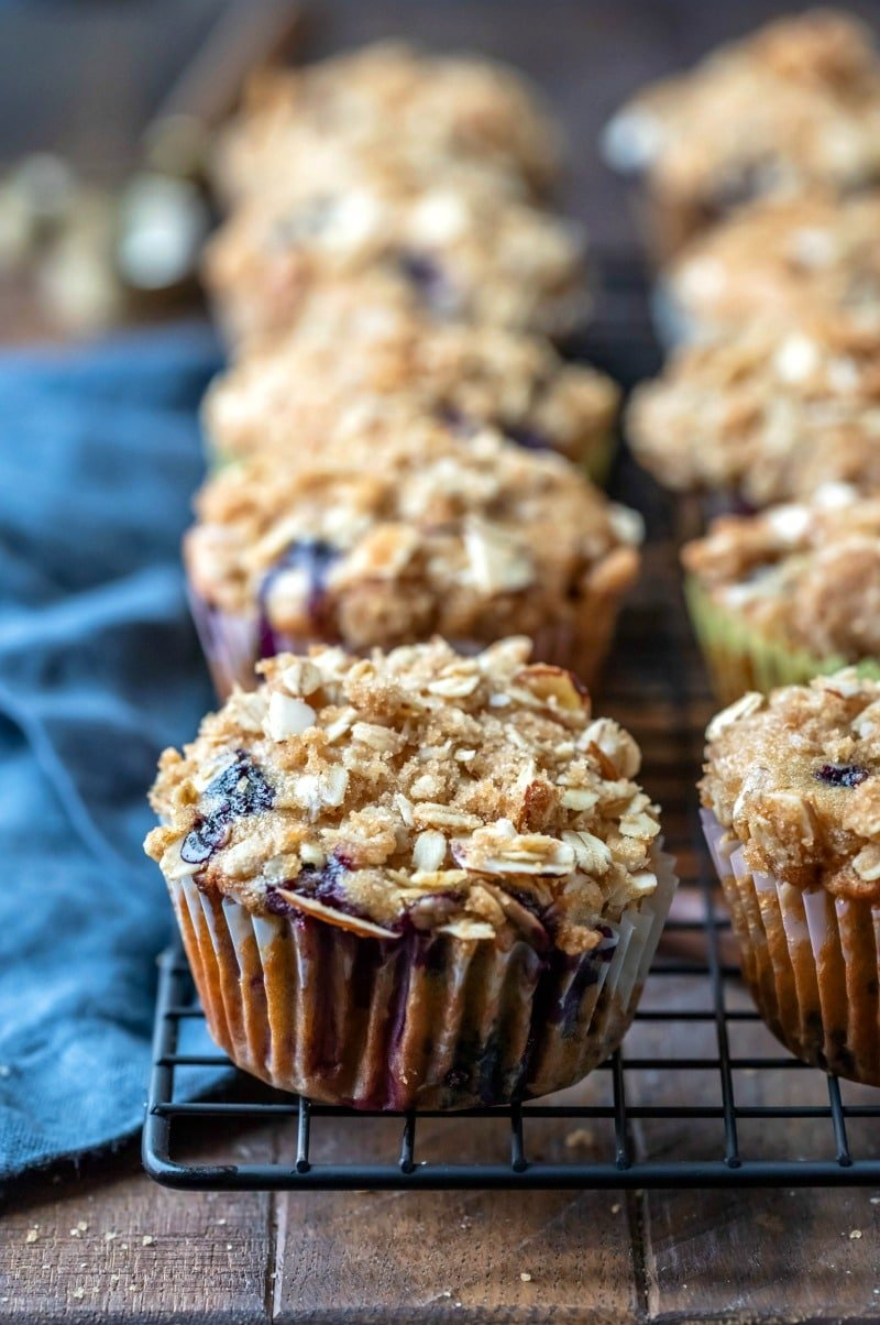 Row of healthy blueberry muffins next to a blue linen napkin
