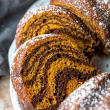 Slices of pumpkin marble cake on a white platter