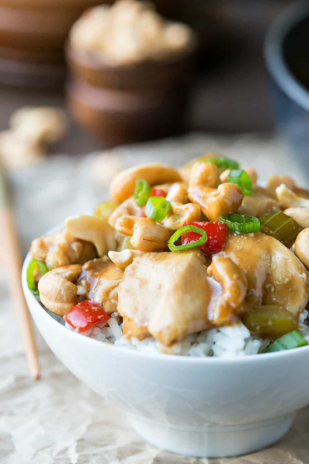 White bowl filled with rice and cashew chicken