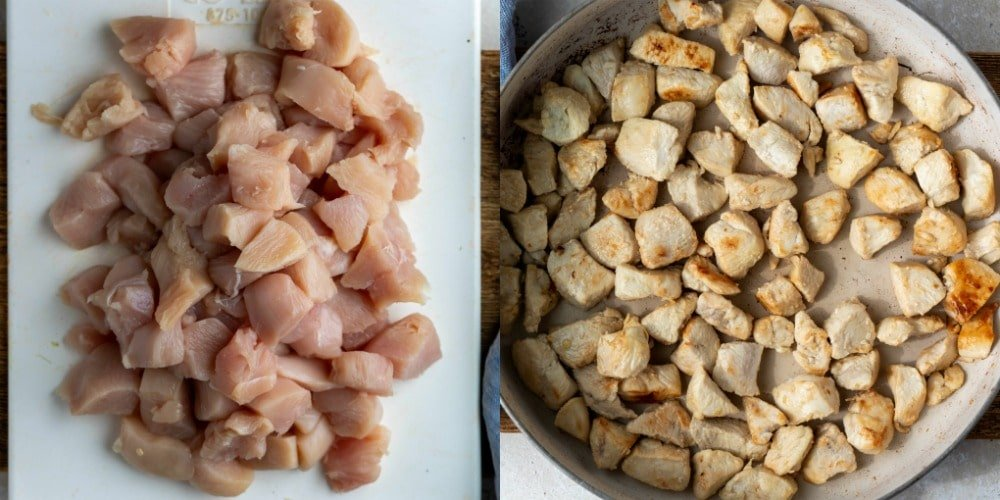 Diced uncooked chicken on a white cutting board