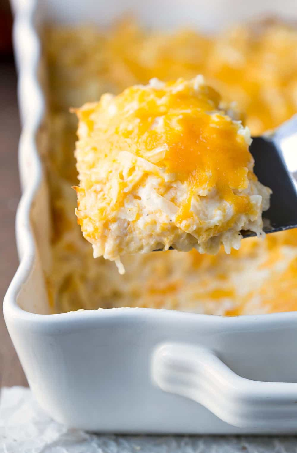 Funeral Potatoes in a white casserole dish