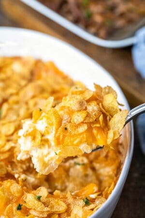 Silver spoon holding a scoop of funeral potatoes