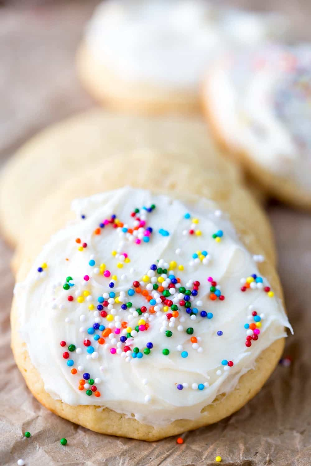 Sour Cream Sugar Cookies with buttercream frosting and sprinkles