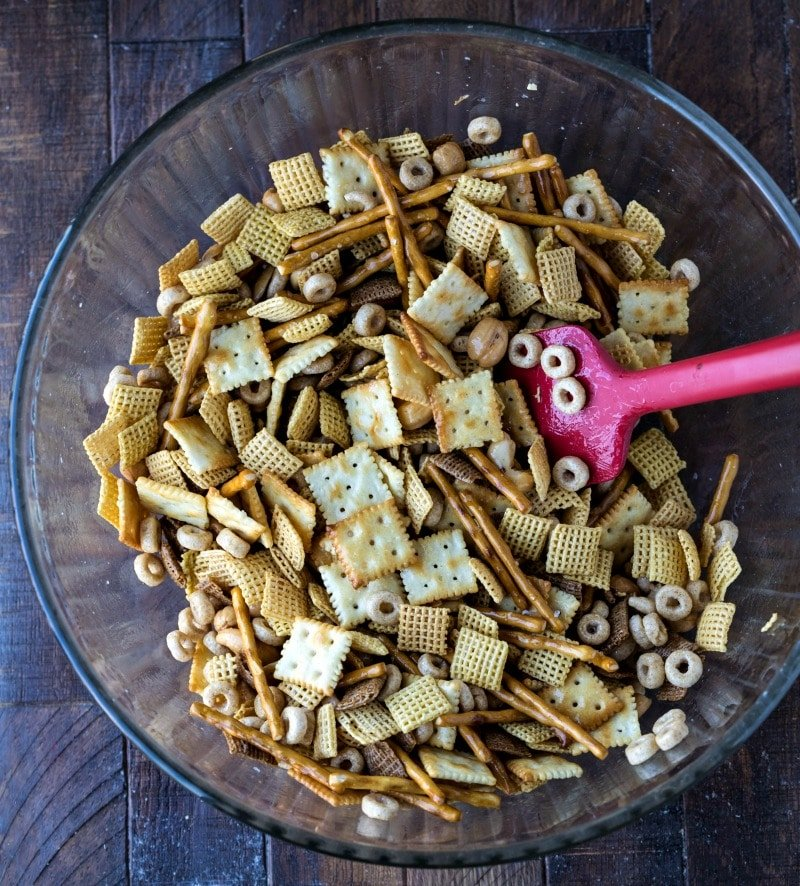 Cinnamon sugar chex mix in a glass mixing bowl