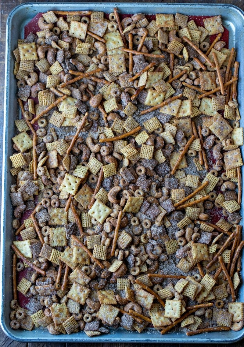 Baked cinnamon sugar chex on a rimmed baking sheet