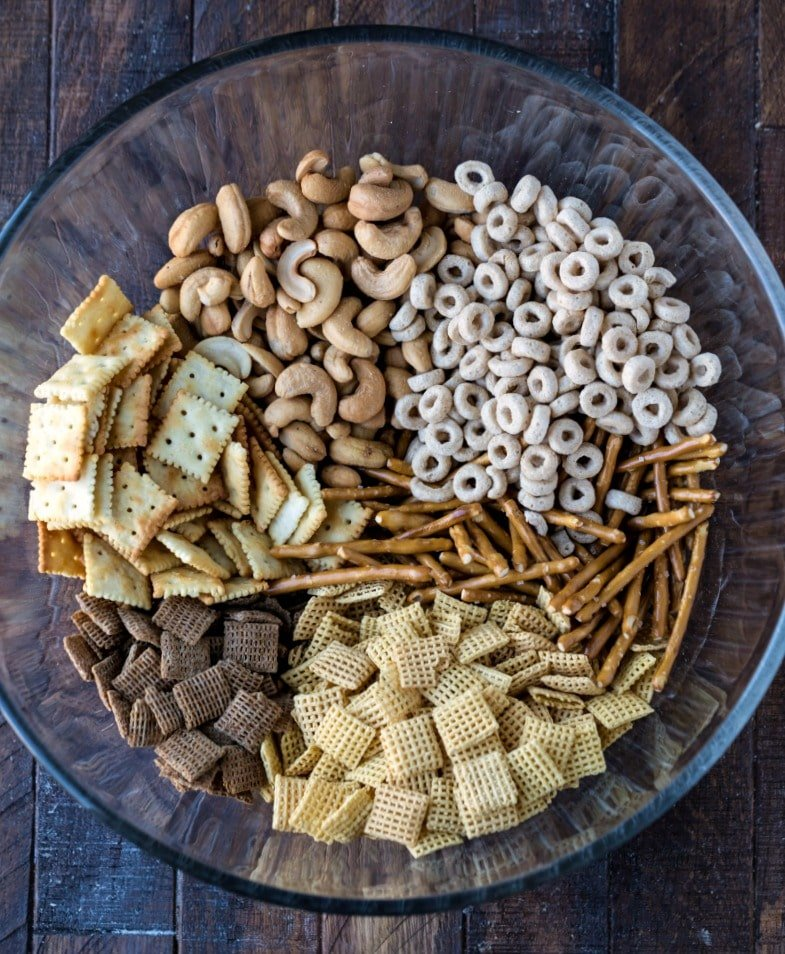 Cinnamon sugar chex mix ingredients in a glass mixing bowl