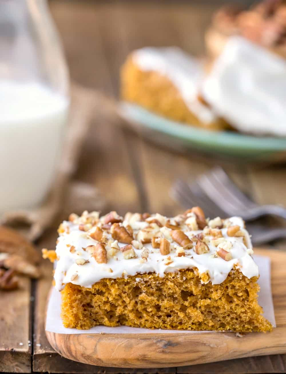 Pumpkin Bar on a piece of white parchment paper on a wooden cutting board