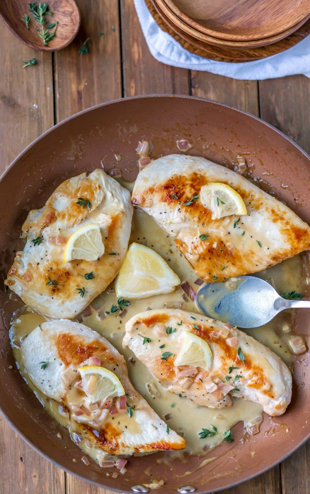 One Skillet Creamy Lemon Garlic Chicken in a copper skillet