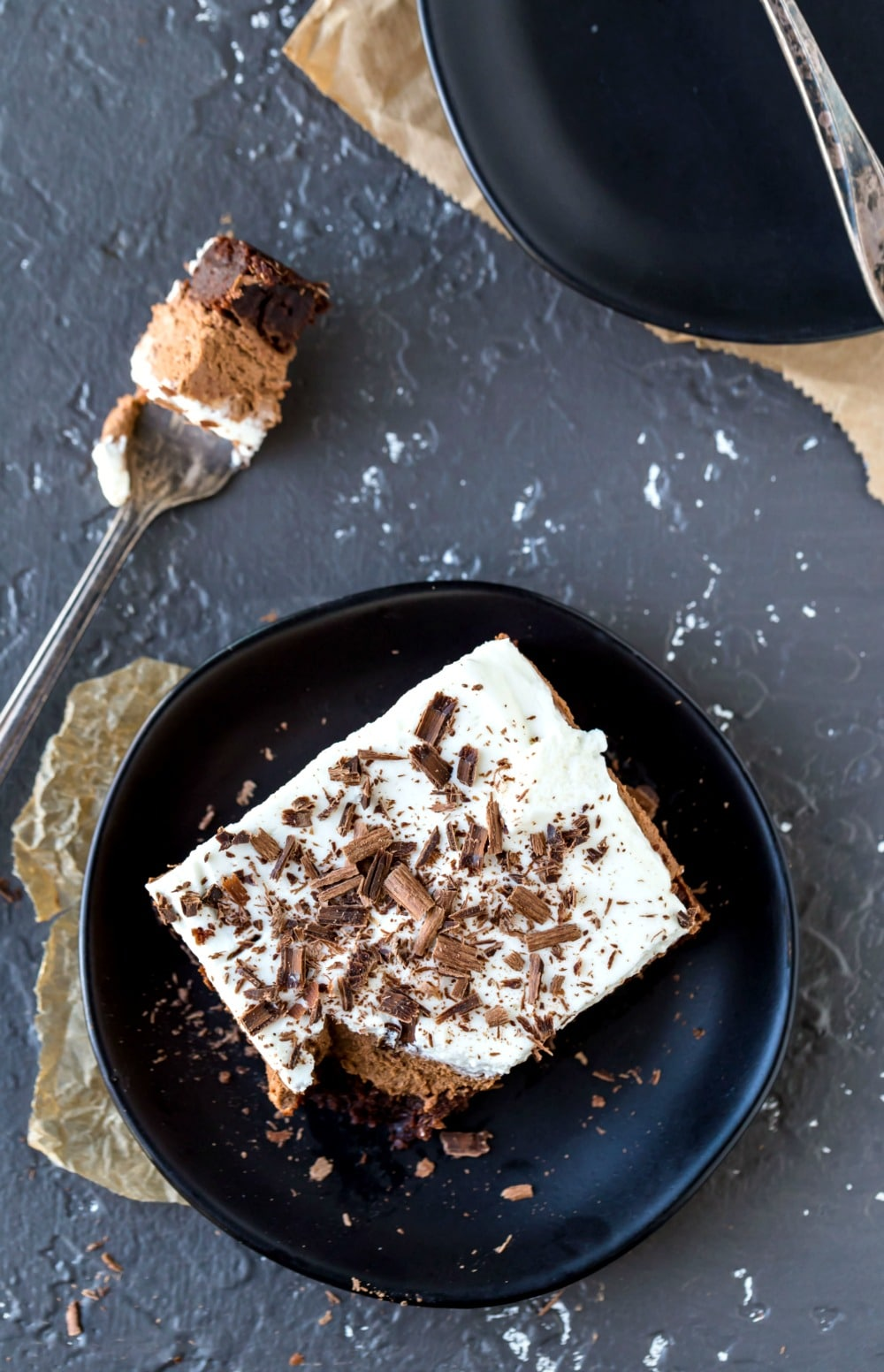 Overhead picture of French silk brownies with bite on fork next to the plate