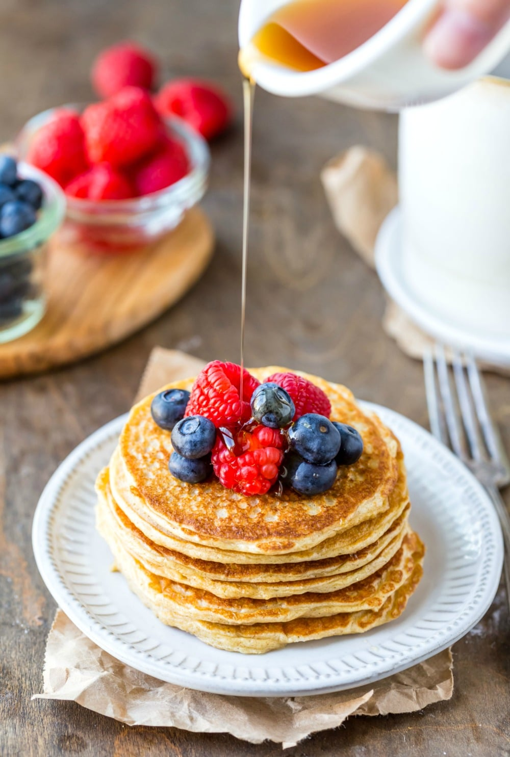 Syrup pouring onto stack of cottage cheese pancakes