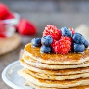 Stack of cottage cheese pancakes with berries on top