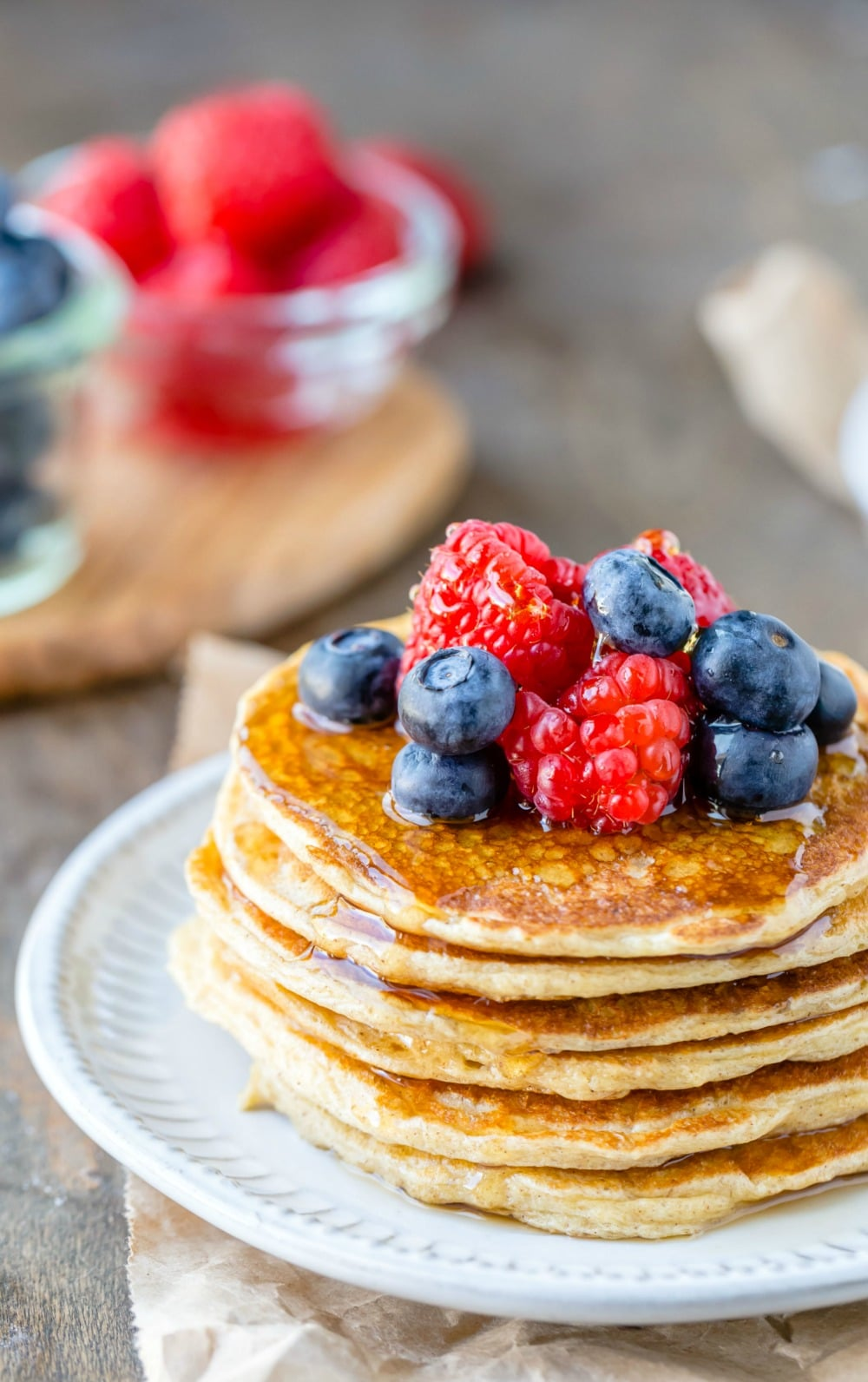 Berries and syrup on stack of cottage cheese pancakes