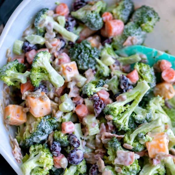 Broccoli Salad in a white mixing bowl