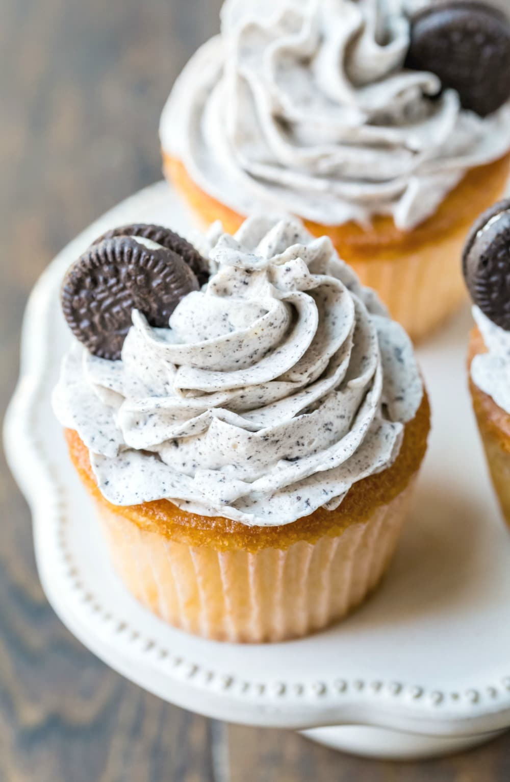 White cupcake with OREO frosting and a mini oreo on top
