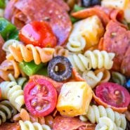 Pasta salad with pepperoni, olives, cheese, and tomatoes