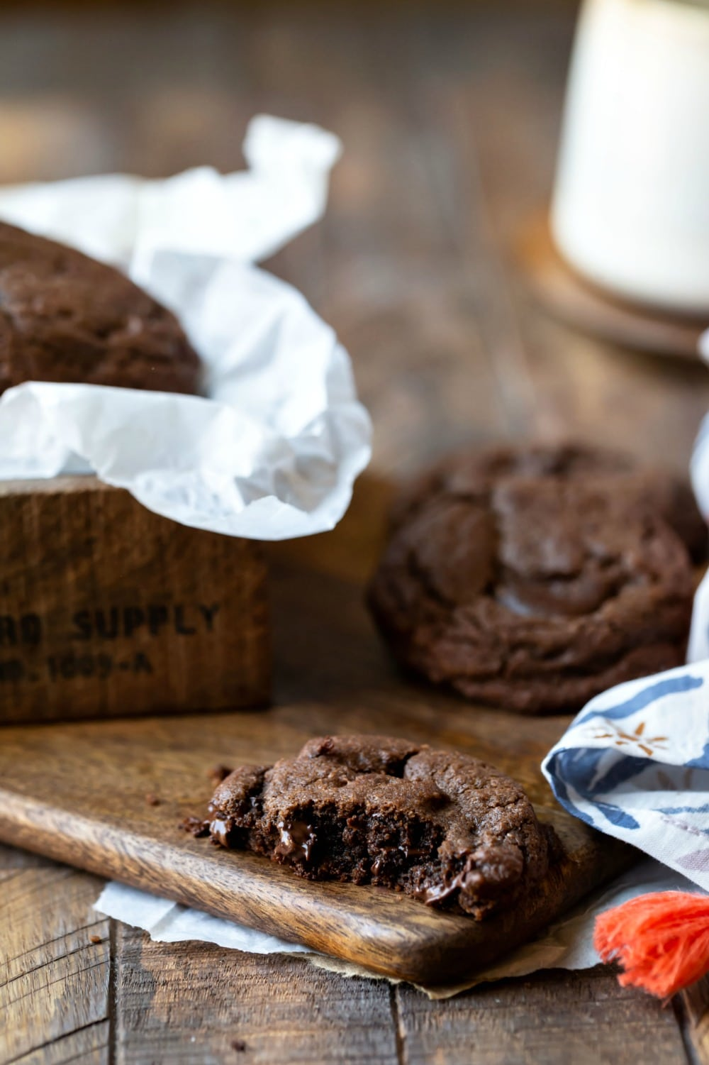 Chocolate Chocolate Chip Cookies next to a print napkin
