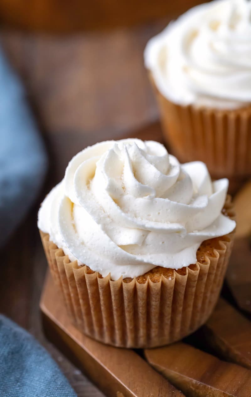 Vanilla buttercream frosting swirled on a vanilla cupcake