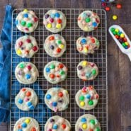 M&M Cookies on a gold wire cooling rack