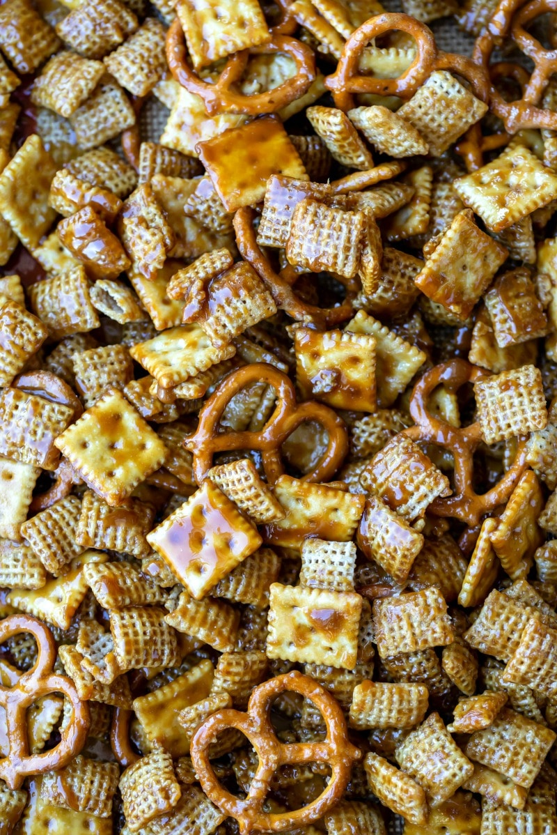 Toffee chex mix in an even layer on a silicone baking mat