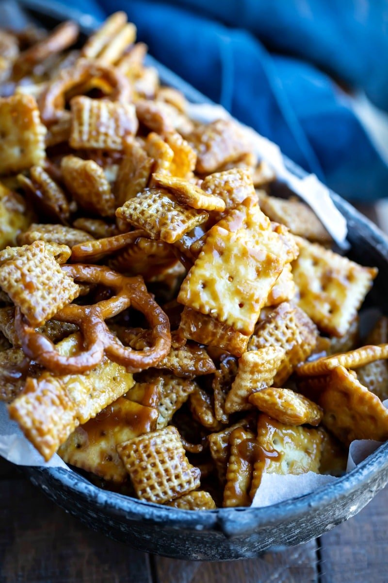 Toffee chex mix in a parchment-lined metal dish