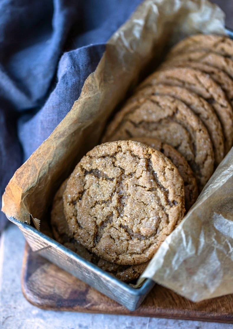 Molasses cookies in a silver metal tin