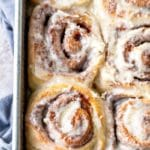 Maple cinnamon rolls in a metal baking pan