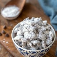 Puppy Chow muddy buddies in a blue and white dish