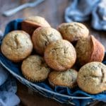 Banana bread muffins in a blue linen lined basket