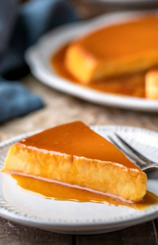 Slice of flan de queso topped with caramel sauce