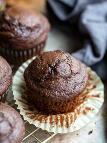 Chocolate chocolate chip muffin with the muffin liner pulled down