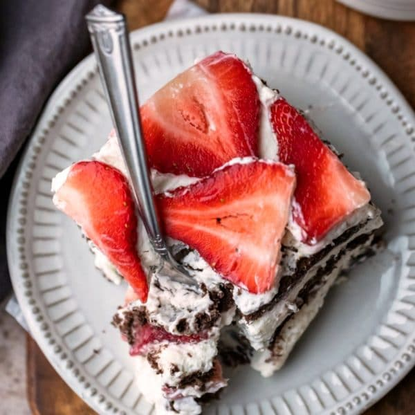 Slice of strawberry icebox cake on a cream plate