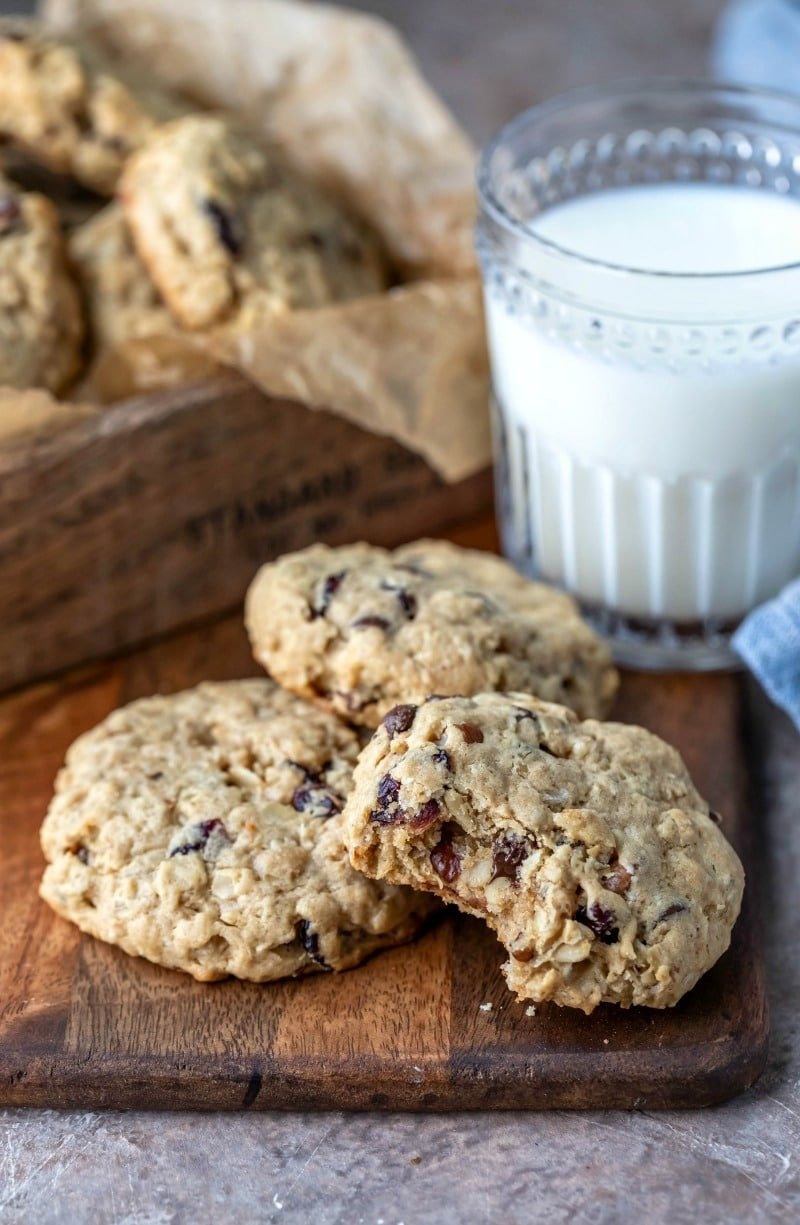 Three breakfast cookies next to a glass of milk