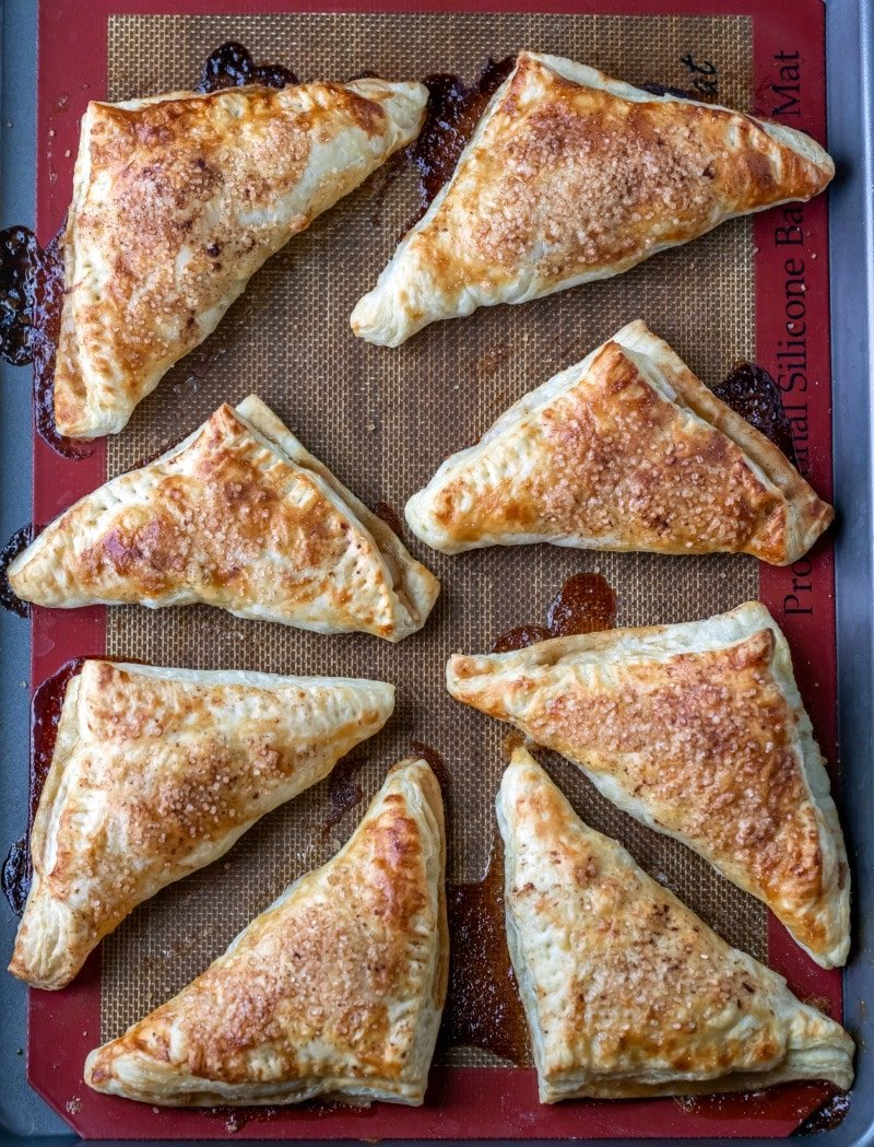 Baked apple turnovers on a baking sheet