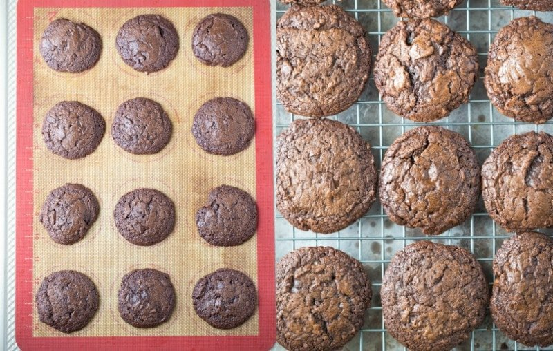 Chocolate fudge cookies on a silicone baking mat