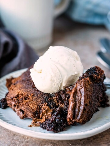 Slow cooker brownies topped with a scoop of vanilla ice cream