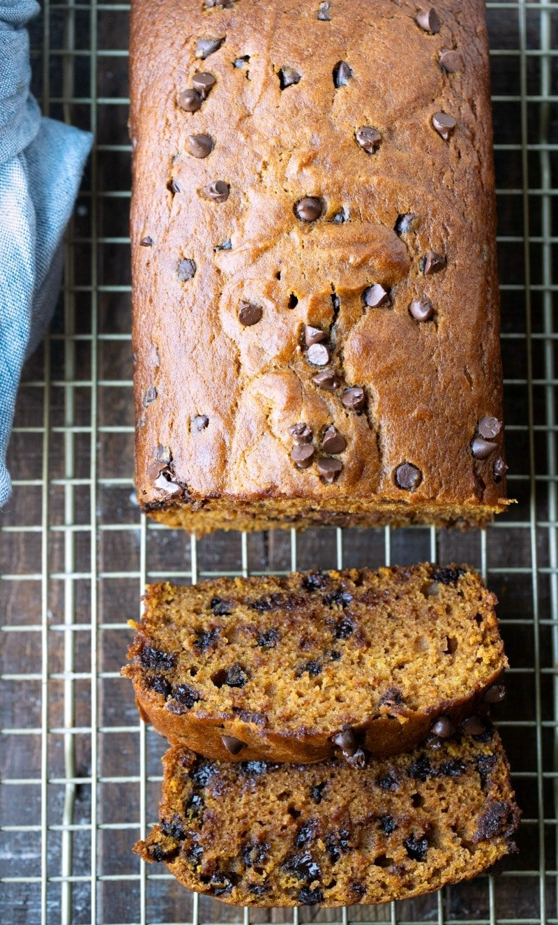 Sliced pumpkin chocolate chip bread on a gold wire cooling rack