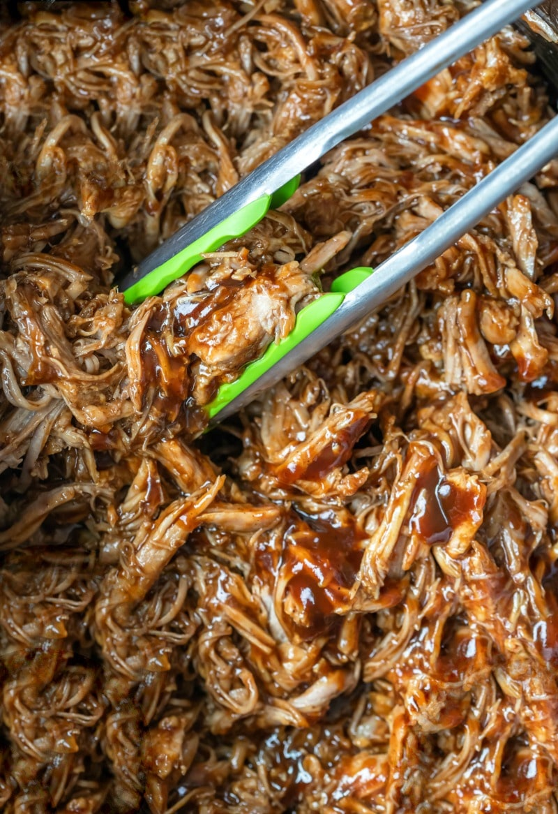 Crockpot pulled pork with barbecue sauce in a crockpot insert