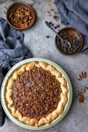 Chocolate Pecan Pie in a gold pie pan
