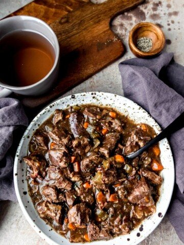 Speckled pottery dish full of slow cooker beef bourguingon