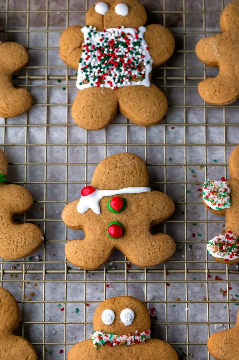 Decorated cut out gingerbread men on a wire cooling rack