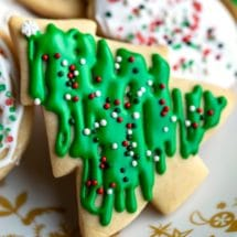 Close up sugar cookie shaped like a Christmas tree