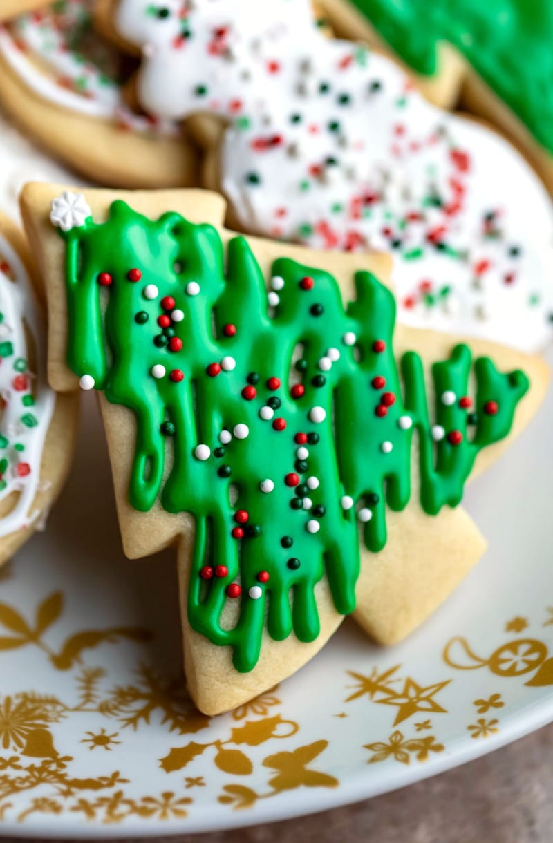 Close up sugar cookie shaped like a Christmas tree