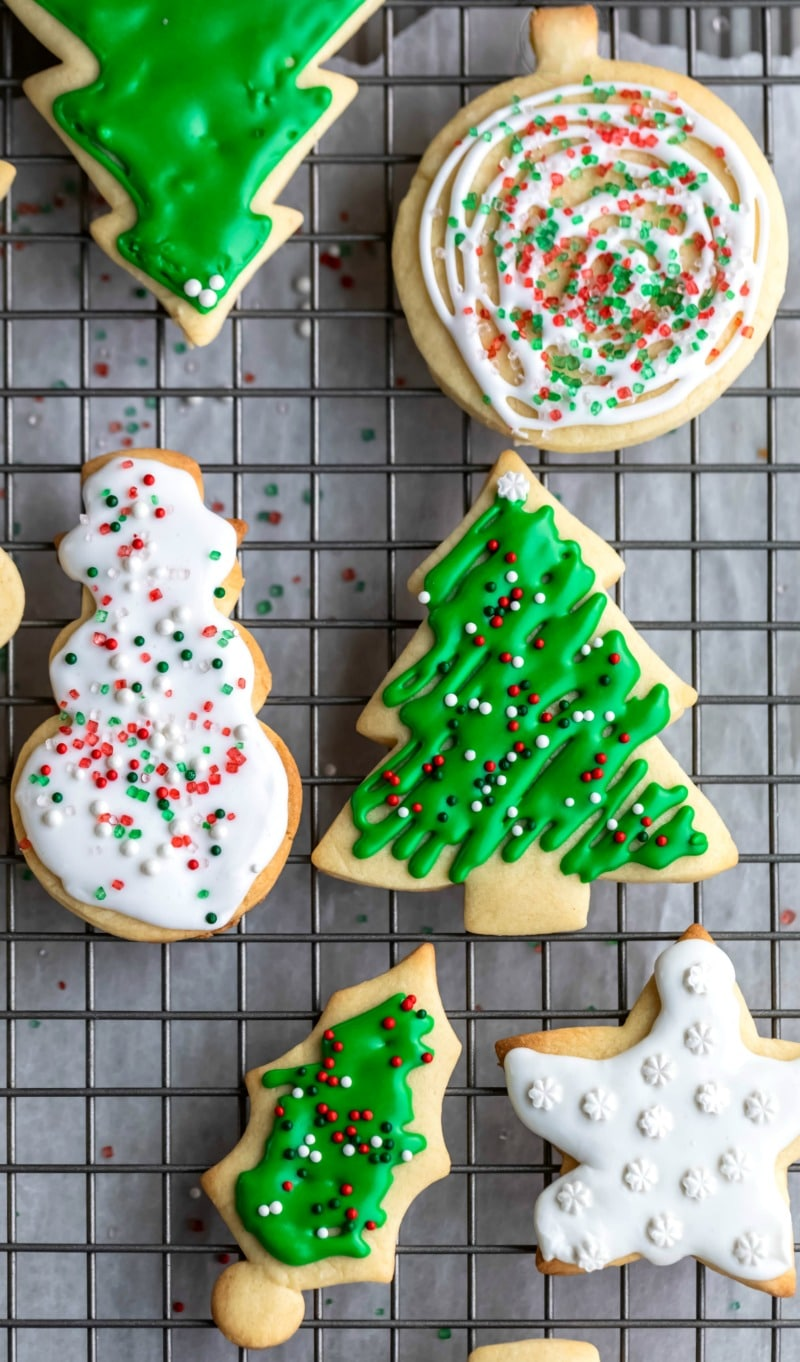 Decorated cut sugar cookies on a wire cooling rack
