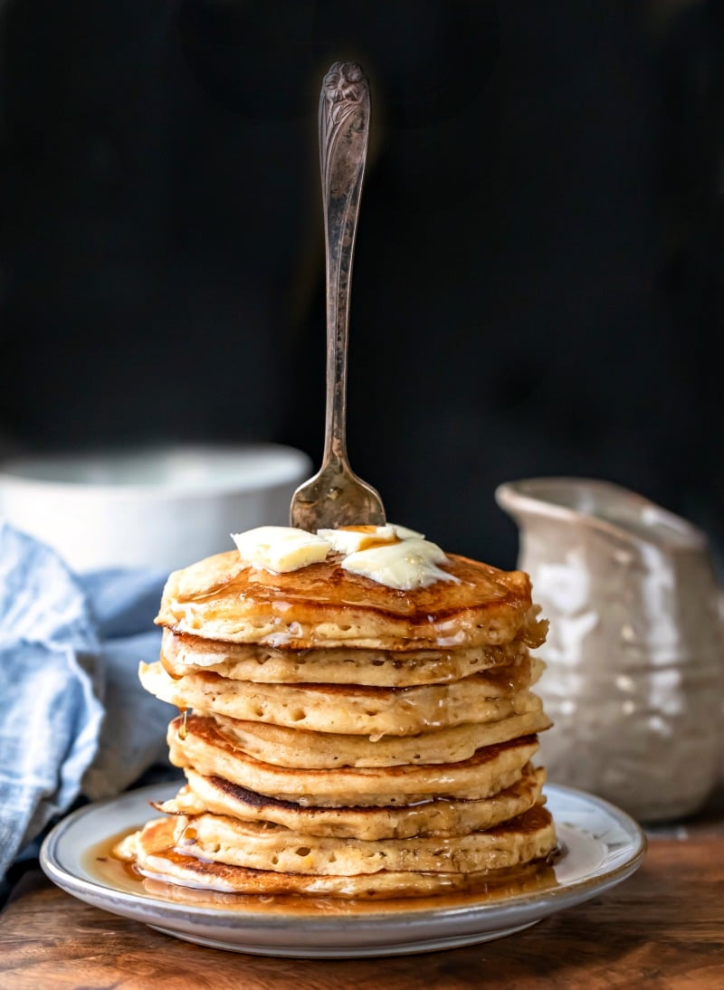 Stack of multigrain pancakes on a blue ceramic plate
