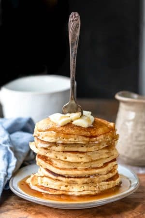 Stack of multigrain pancakes with a fork sticking out of them