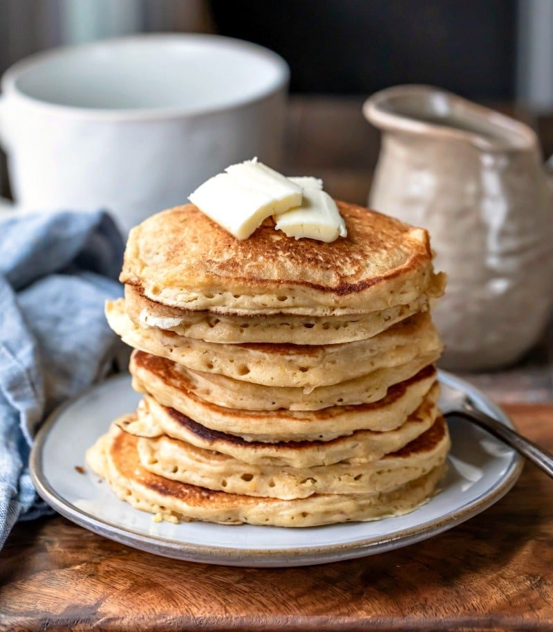 Stack of multigrain pancakes with pat of butter on top
